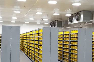 A climate controlled warehousing image with humidity controlled systems attached to the ceiling
